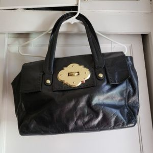 Beautiful black leather satchel. Gold accent hardw